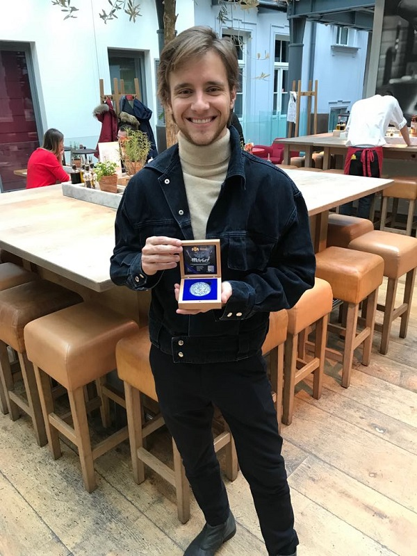 Maciej Musiał with the Witcher Coin